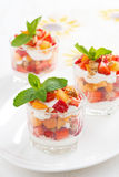 Dessert with strawberries, apricots, whipped cream and mint Royalty Free Stock Photo