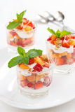 Dessert with strawberries, apricots, whipped cream and mint Royalty Free Stock Photos