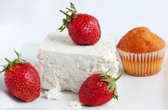 Dessert with strawberries,  cheese and cake. Dessert with strawberries, fresh cheese and a delicious cake Royalty Free Stock Photography