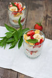 Dessert with strawberries. Cheese, strawberry, banana, cornflakes on the table. Breakfast Royalty Free Stock Images
