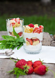 Dessert with strawberries. Cheese, strawberry, banana, cornflakes on the table. Breakfast Royalty Free Stock Photo