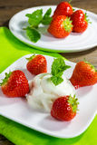 Dessert with strawberries and cream Stock Images