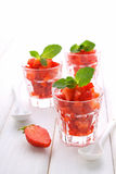 Dessert of strawberries decorated with mint leaves Stock Photography