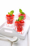 Dessert of strawberries decorated with mint leaves Stock Photo