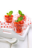 Dessert of strawberries decorated with mint leaves Stock Images