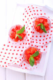 Dessert of strawberries decorated with mint leaves Royalty Free Stock Images