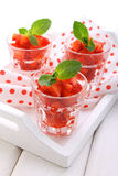 Dessert of strawberries decorated with mint leaves Royalty Free Stock Image