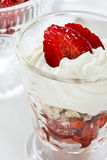 Dessert with strawberries, whipped cream and biscuit Royalty Free Stock Images