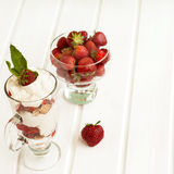 Dessert of strawberries, whipped cream and pastry Stock Photos