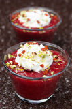 Dessert with strawberry jam and whipped cream Stock Photography