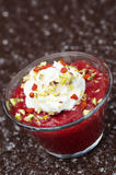 Dessert with strawberry jam and whipped cream closeup vertical Royalty Free Stock Images