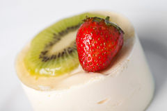 Dessert with a strawberry and kiwi. On white plate Royalty Free Stock Photography