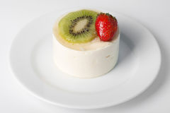 Dessert with a strawberry and kiwi. On white plate Royalty Free Stock Photos