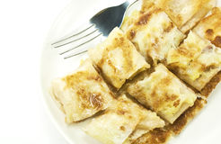 Dessert style of fried roti with banana inside. Close-up of dessert style of fried roti with banana inside in Thailand Stock Images
