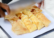 Dessert style of fried Roti with banana in Thailand Stock Image