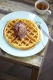 Dessert in summer. Chocolate icecream waffle and tea Stock Photo