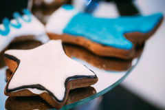 Dessert Sweet Cookies in shape of a star and a boot in Candy Bar Stock Photo