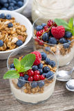 Dessert with sweet cream, fresh berries and granola, vertical. Top view Royalty Free Stock Photo