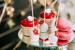 Dessert Sweet Tasty Cupcakes And Macarons In Candy Bar On Table. Royalty Free Stock Photo
