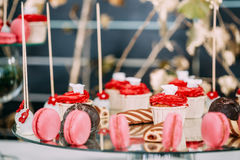 Dessert Sweet Tasty Cupcakes, Macarons And Cookies In Candy Bar Stock Photo