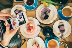 Dessert sweets party time. Mobile photo food blogger. Top view restaurant cafe breakfast. CAkes and tea time stock photos