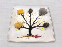 Dessert with syrup tree drawing. On linen textile background stock photography
