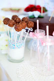 Dessert table. Chocolate cake pops on a dessert table at party or wedding celebration Stock Photo