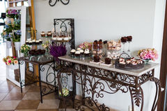Desserts table setting idea. Chocolate dessert table for a wedding party: cupcakes, cacao truffles, meringue biscuits, cake pops stock photo