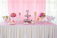 Dessert table decoration sweats. Dessert table decoration flowers sweats Stock Images