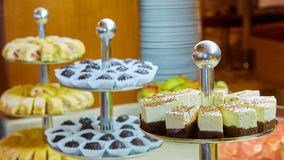 Dessert table for party. akes and sweetness. Shallow dof Stock Image