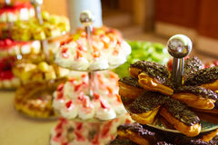 Dessert table for party. akes and sweetness. Shallow dof Stock Photo