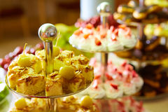 Dessert table for party. akes and sweetness. Shallow dof Royalty Free Stock Photos