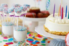 Dessert table at party. Cake, candies, marshmallows, cakepops, fruits and other sweets on dessert table at kids birthday party Royalty Free Stock Photos