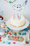 Dessert table at party. Cake, candies, marshmallows, cakepops, fruits and other sweets on dessert table at kids birthday party Royalty Free Stock Photo