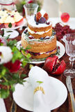 Dessert table for a party. Cake, cupcakes, sweetness and flowers Royalty Free Stock Image