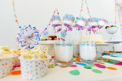 Dessert table at party. Colorful decoration of kids birthday party table with popcorn and sweets Stock Photography