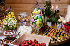 Dessert table on party. Macaroon, cake with berries and other sweets jn party table royalty free stock photo