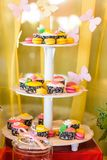 Dessert table for a party. Ombre cake, cupcakes Royalty Free Stock Photography