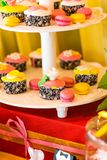 Dessert table for a party. Ombre cake, cupcakes Royalty Free Stock Image