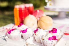 Dessert table for a party. Ombre cake, cupcakes, sweetness and f Royalty Free Stock Photo