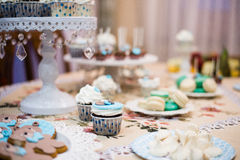 Dessert table for a party. Ombre cake, cupcakes, sweetness and flowers Stock Photos