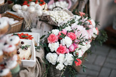 Dessert table for a party. Ombre cake, cupcakes, sweetness and flowers. selective focus Royalty Free Stock Images