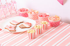 Dessert table in pink at girls party Stock Photo