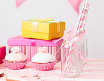 Dessert table and presents at girls party Stock Image