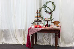 Dessert table in restaurant Stock Photo