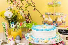 Easter brunch. Dessert table set with cake and cupcakes for Easter brunch Stock Image