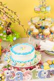 Easter brunch. Dessert table set with cake and cupcakes for Easter brunch Royalty Free Stock Photography