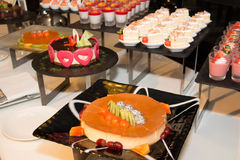 Dessert table, sliced fruits, cakes Royalty Free Stock Photography