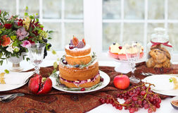 Dessert table for a wedding. Cake, cupcakes, sweetness and flowe Stock Photo