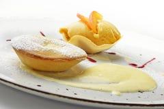 Dessert tart apricot with apricot ice cream Stock Photos
